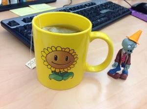 Hot tea in my Plants vs. Zombies sunflower mug