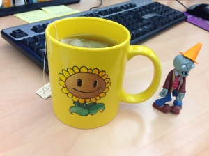Hot tea in my Plants vs. Zombies sunflower mug