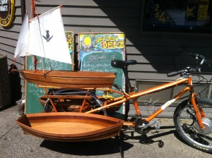 Davey Jones cargo bike with sailboat. Photo credit: foodiecrowdfunding.com